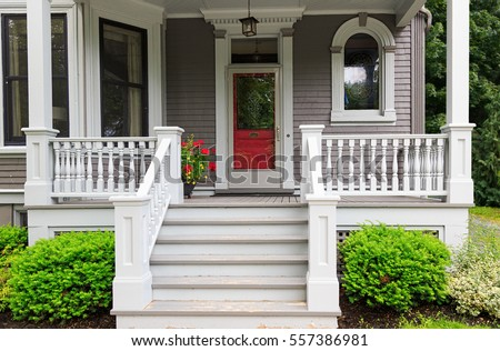 The front porch of a traditional older home.