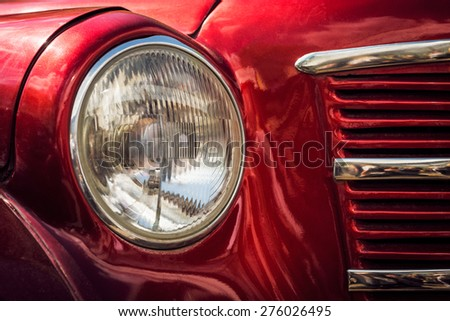 the front side of a  retro car with a light  - stock photo