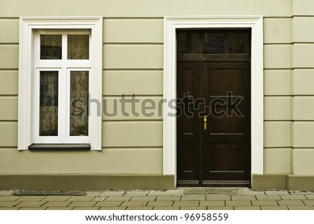 the front wall with door and window - stock photo