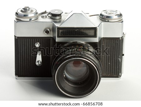The frontal view of an old and dusty russian Zenit camera on film with lens. - stock photo