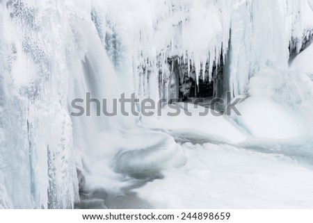 The frozen Kirkjufell waterfall - stock photo