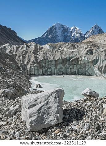 The frozen lake on Khumbu glacier - Nepal, Himalayas - stock photo