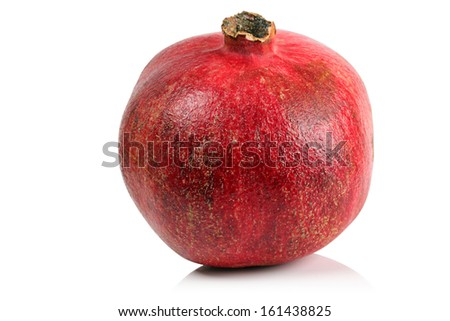 The fruit of a ripe pomegranate on a white background