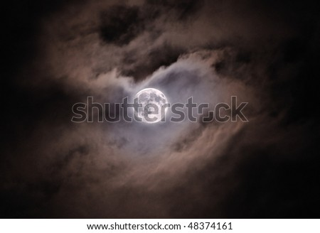 The full moon in cloudy sky