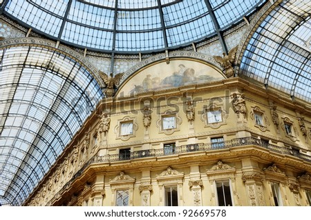 The Galleria Vittorio Emanuele II is a covered double arcade formed of two glass-vaulted arcades at right angles intersecting in an octagon. Piazza del Duomo  in Milan, Italy. - stock photo