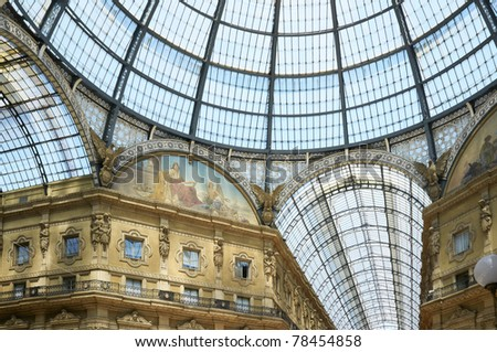 The Galleria Vittorio Emanuele II is a covered double arcade formed of two glass-vaulted arcades in an octagon, prominently sited on the northern side of the Piazza del Duomo in Milan - stock photo
