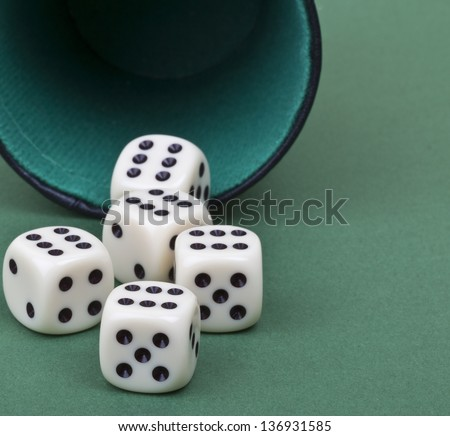The game of dice on green table - stock photo