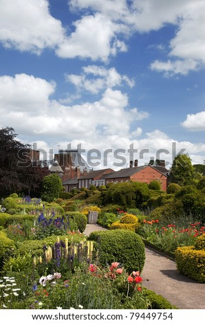 The garden of Nash's house, Stratford-upon-Avon. This house was bought by William Shakespeare for his granddaughter. The Royal Shakespeare Theatre can be seen in the background. - stock photo