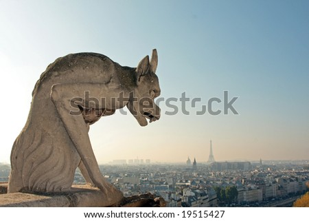 The Gargoyles of Notre Dame looking out over Paris - stock photo