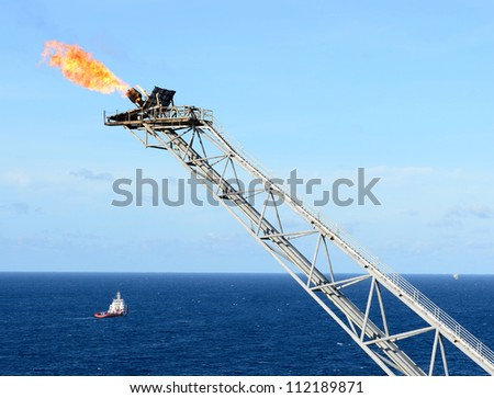 The gas flare is on the offshore oil rig platform in the gulf of thailand.