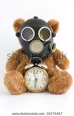 The Gas mask and old watch on white background. - stock photo