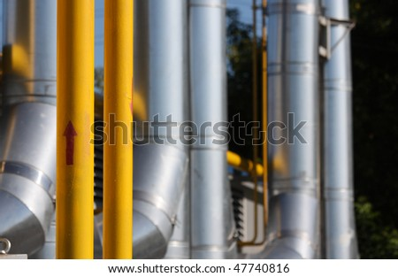 The gas pipeline - focus on yellow pipe with red arrow - stock photo