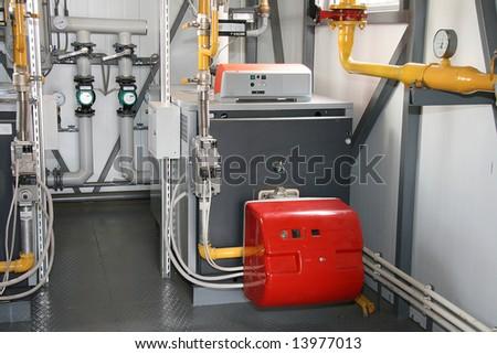 The gas steel boiler established in modern independent boiler-house - stock photo