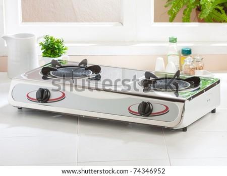 The gas stove with two gas plate for faster cooking - stock photo