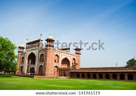 the gate into the taj mahal - stock photo