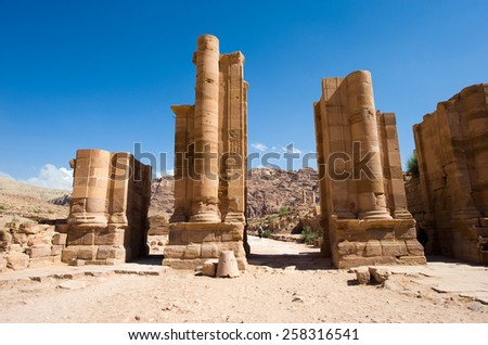 The gate on Colonnaded street in front of the great Temple in Petra in Jordan - stock photo