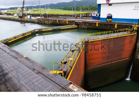 The gates at the Gatun Locks on the Panama Canal with the pool in the background - stock photo