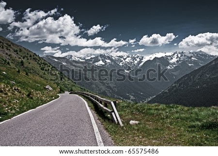 The Gavia Pass in Italy. Empty road vista in the Italian Alps. - stock photo