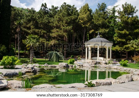 the gazebo in the antique style, with columns on the waterfront, Park Aivazovsky, Crimea, Russia - stock photo