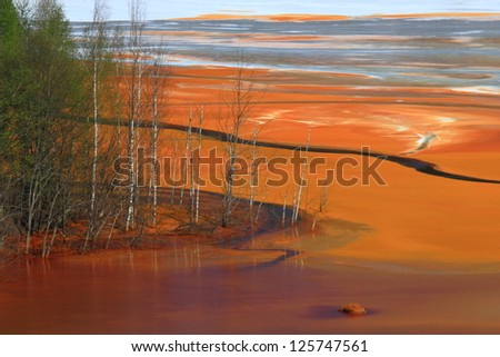 The Geamana lake's water polluted by copper mining, Romania - stock photo