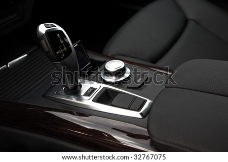 The gear-change lever in the modern car - stock photo