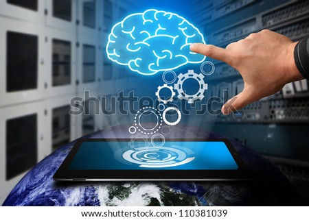The gear to be a genius from touch pad in data center room : Elements of this image furnished by NASA - stock photo