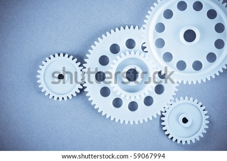the gears meshing together(teamwork concept) - stock photo