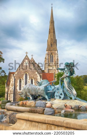 The Gefion Fountain in front of the St. Alban's Church (or the English Church) in Copenhagen, Denmark. - stock photo