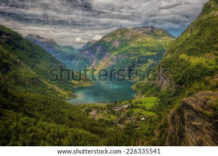 The Geiranger fjord in Norway, surrounded by high mountains - stock photo