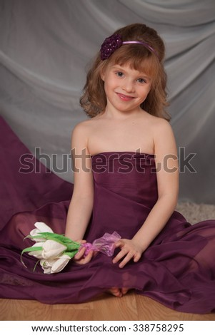 the gentle nice girl with flowers on a light background  - stock photo