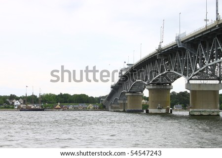 The George P Coleman bridge overlooking the Yorktown waterfront from the Gloucester point beach - stock photo