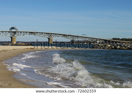 The George P Coleman Swing Span Bridge over the York river in Virginia with Yorktown Beach in the foreground with room for your text. - stock photo