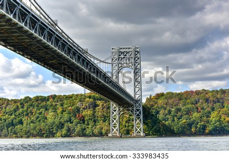 The George Washington Bridge spanning New York and New Jersey from the Hudson River in Autumn.