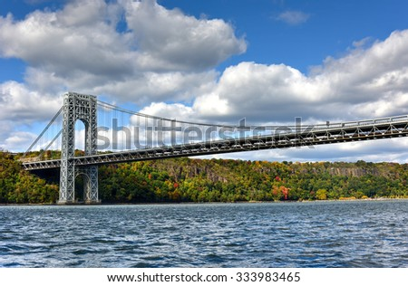 The George Washington Bridge spanning New York and New Jersey from the Hudson River in Autumn. - stock photo