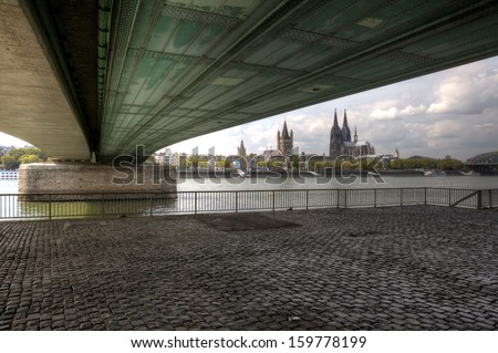 The German city of Cologne, as seen from under the Deutzer Bridge. - stock photo