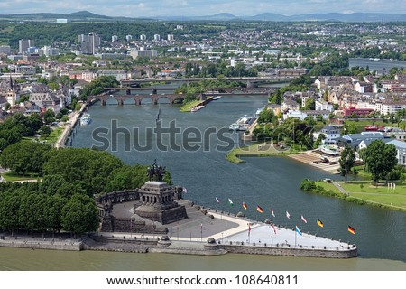 The German Corner (Deutsches Eck) at the confluence of Rhine and Mosel rivers in Koblenz with equestrian statue of William the Great, Germany - stock photo