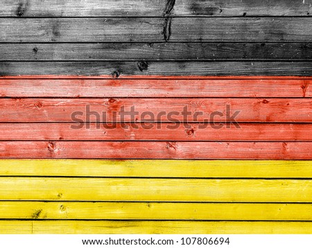 The German flag painted on wooden fence
