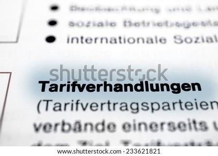 "the German word ""Tarifverhandlungen"", translation: Collective Negotiations - stock photo"