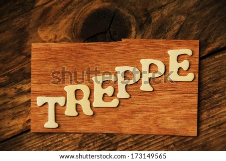the German word TREPPE ( stairs ) on wood