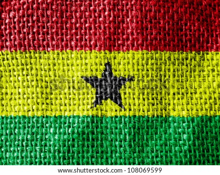 The Ghana flag painted on fabric surface - stock photo