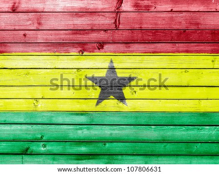 The Ghana flag painted on wooden fence - stock photo