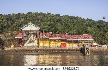 The giant reclining Buddha at the harbor of Myeik in the south of Myanmar. - stock photo