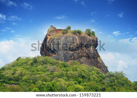 The giant Sigiriya Rock Fortress in Sri Lanka - stock photo