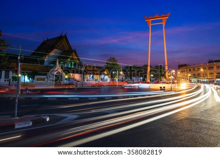 The Giant Swing and Suthat Temple at Twilight in Bangkok, Thailand - stock photo