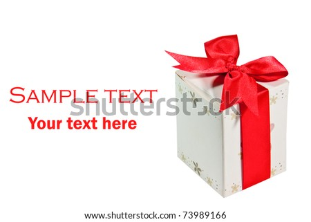 The Gift box with red ribbon isolated on white background - stock photo