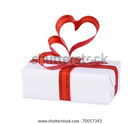 The gift decorated with a tape with hearts on the white