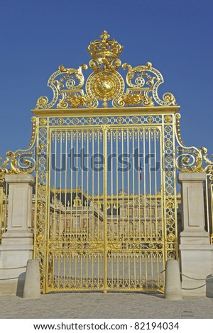The gilded front gate of the Palace of Versailles near Paris