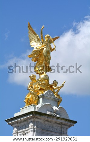 The gilded Winged Victory at the top of Victoria Memorial, London, UK. - stock photo