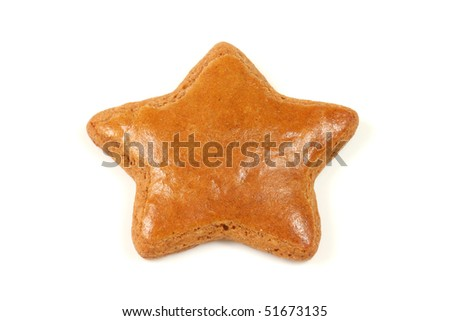 The gingerbread star isolated over white - stock photo