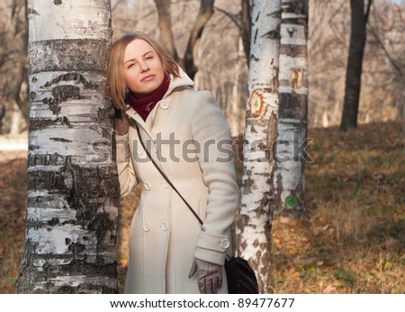 The girl against birches - stock photo